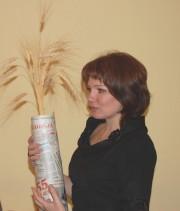 Газету с юбилеем поздравляет Е.А. Козловцева